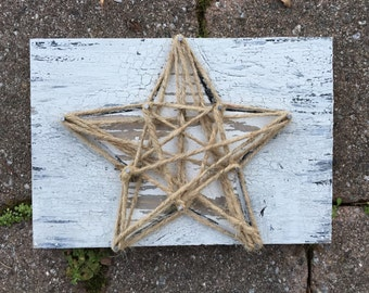 rustic string art twine jute star on weathered worn white and gray wood