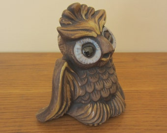 Winking brown ceramic owl with glossy highlights.   Charm!