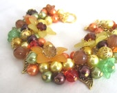 Autumnal colours, orange, green, brown, yellow,  loaded bead charm bracelet  for any occasion  #211 UK SELLER