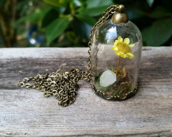 Terrarium necklace with yellow flower and white quartz crystal