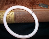 Vintage Trifari bangle bracelet. Soft pink, oval shape with original tag