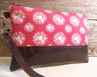 Large Wristlet in a red flower fabric and faux leather accent , leather strap , wallet with zipper, bag for cell phone.