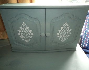 """Hand painted bathroom cabinet in Annie Sloane's """"Duck egg blue, with stencil."""
