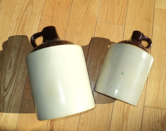 2 ANTIQUE MOONSHINE JUGS,  An Instant collection of two different sized brown and white glazed ceramic jugs with well developed patina