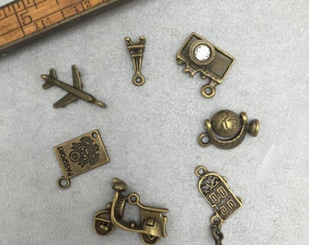 7 piece antique bronze travel charm set  all 3 d style  with real spinning globe charm