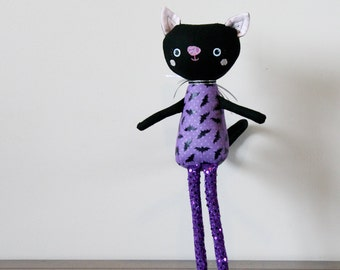 Black Cat Stuffed Animal, Softie, Plushie Named Simone. Purple and Black Bat Print Fabric, with Sparkly Legs.