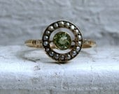 Antique Peridot and Pearl Halo Ring in 18K Yellow Gold.