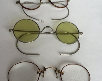 A set of 3 vintage eyewear.French specs. 1920