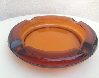 Vintage mid century heavy ashtray amber glass 8""