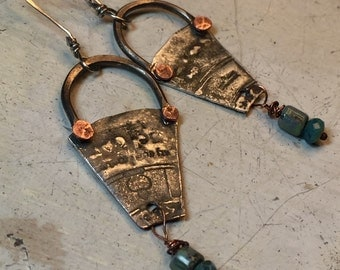 rustic earrings zodiac textured, rivited metal in blue, green, copper, and silver one has a taurus symbol