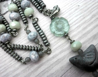 Boho bird necklace in soft tones of grey & sage, with hand crafted ceramic and pewter bird beads and Czech glass beads UK shipping