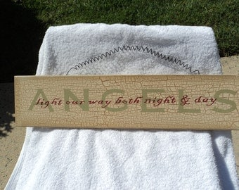 Wooden sign/ distressed appearance/ rustic/ metal wire and saw tooth hanger/ Angels light our way both night and day