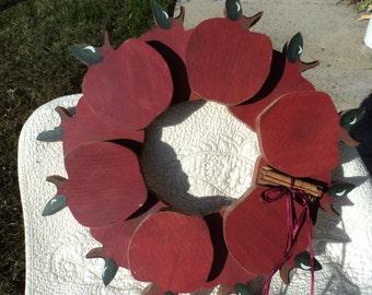 Wooden handmade wreath of apples, ribbon, and cinnamon sticks/folk art