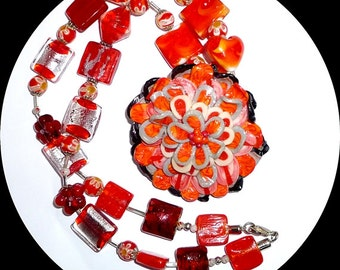 Wow! Oh my, golly, gosh, heck. Polymer clay and glass necklace