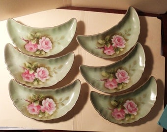 Antique Six  dishes, crescent shaped painted pink roses grren under color