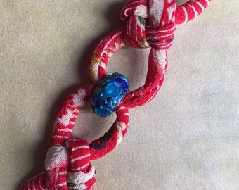 Japanese Chirimen cord knot bracelet vermilion+ Swarovski Becharmed