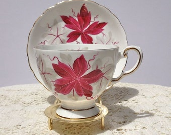 Vintage cup and saucer hand-painted by Tuscan