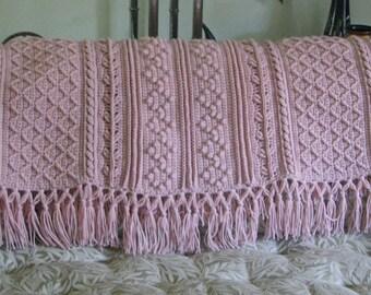 Light pink Aran  crocheted afghan
