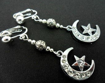 A pair of pretty diamante  silver plated moon and star dangly clip on earrings.
