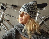 Hand knit wool hat light blue with gray signes