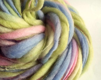 Thick and thin knitting yarn / wool, merino wool in pastel shades of lime greens, pink and lavender blue, big knitting wool