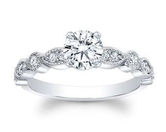 Ladies Platinum antique engagement ring with 1 carat Round Brilliant White Sapphire and 0.20 ctw diamonds