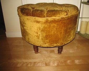 Oval shaped velvet covered stool. Foot rest.