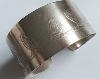 Etched silver bangle with bird design