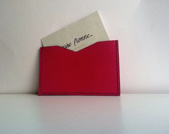 Pink leather card holder.