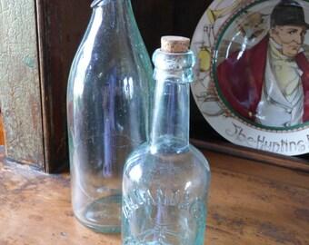 Two antique Aqua Bottles