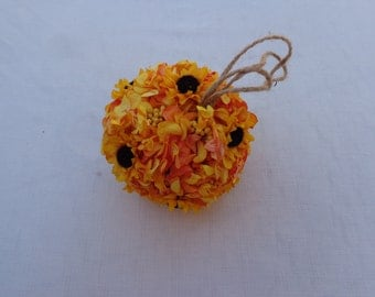 Flower girl kissing ball with sunflowers