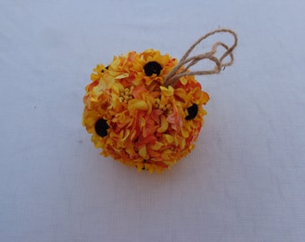 Flower girl kissing ball with sunflowers