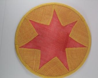 Orange and yellow sinamay saucer hat.