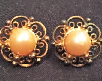 Clip on gold and pearl earrings
