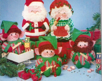Santa and Mrs. Claus and Santa's Elves, 11 Inch Santa and Mrs. Claus using Coffee Cans, Elves 9 Inches Tall Using Peanut Cans Butterick 5599