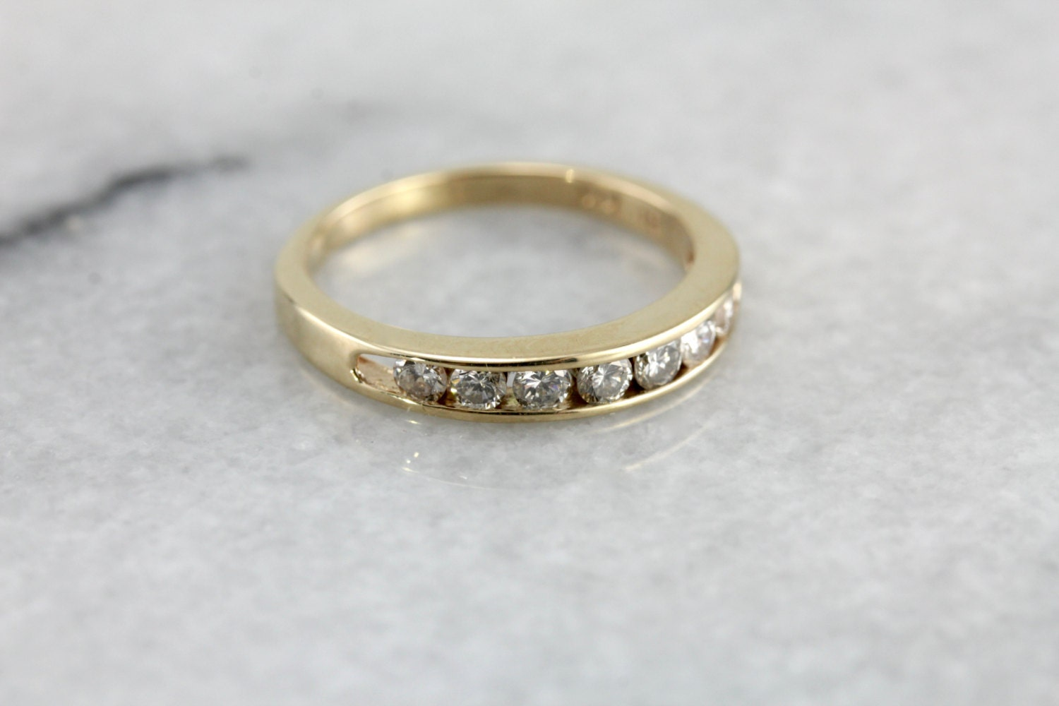 Diamond channel set wedding band in yellow gold gorgeous vintage