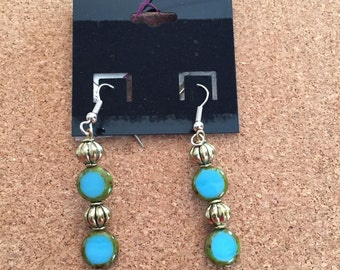 Gold and blue earrings, match the seahorse pendant necklace