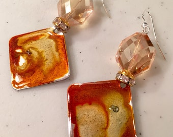 One of a kind alcohol ink dyed aluminum earrings with champagne crystal.