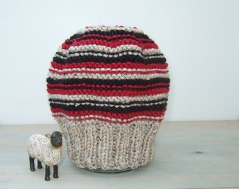 Hand knitted stripy beanie hat in oatmeal, red and black