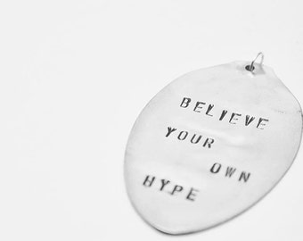 "Inspirational hand stamped pendant made from antique silver plated flatware spoon ""believe your own hype"""