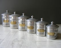 Set of 6 Vintage French  Aluminum Canisters,Kitchen Canisters with brass labels.