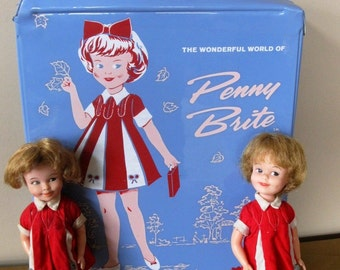 """1964 PENNY BRITE carrying case with 2 Penny Brite dolls - original dress - Topper Toys -vinyl doll case - De Luxe Reading Corp - 8 1/4"""" high"""
