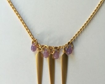 Gold played necklace with charms and amethyst stones