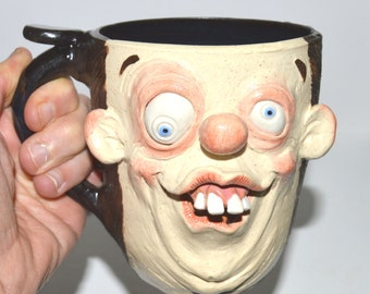 Doofus Mug with buck teeth/big ears. Handsculpted stoneware signed J Cotton One of a kind-lg., 14 oz