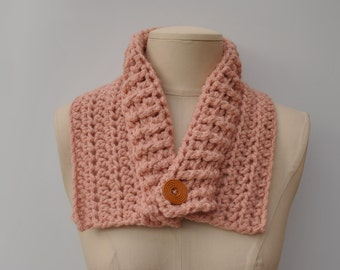 Light pink cowl with wooden button fastening