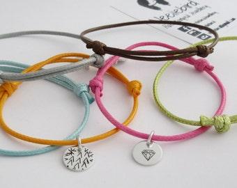 Adjustable handstamped cord bracelets