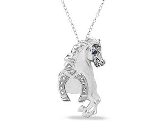 "sterling silver horse pendant with horseshoe and genuine sapphire eye on an 18"" sterling silver cable chain"