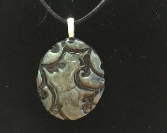 Hand made, stamped pendant