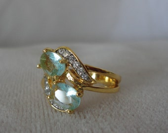 Iresistible Blue Topaz CZ Gold Plated Ring (7.5)************.