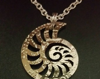 Nautilus seashell cut from a Kennedy half dollar beach ocean coin jewelry
